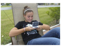 Girl on mobile device -preparing to tell the story for Zipit wireless