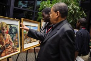 image of Man viewing art collection of african leaders - pr firm
